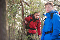 Male backpackers in forest