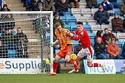 Barnsley forward Kieffer Moore (19) and Gillingham FC goalkeeper Tomas Holy (1)  during the EFL Sky Bet League 1 match between Gillingham and Barnsley at the MEMS Priestfield Stadium, Gillingham, England on 9 February 2019.