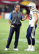 San Diego Chargers linebackers coach Mike Nolan talks to San Diego Chargers linebacker Brock Hekking (59) bear the sideline during the 2015 NFL preseason football game against the Arizona Cardinals on Saturday, Aug. 22, 2015 in Glendale, Ariz. The Chargers won the game 22-19. (©Paul Anthony Spinelli)
