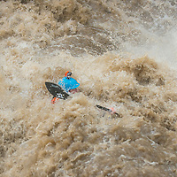 With record water levels for December, a kayaker floats through Husum Falls on the White Salmon River, near Husum, Washington.