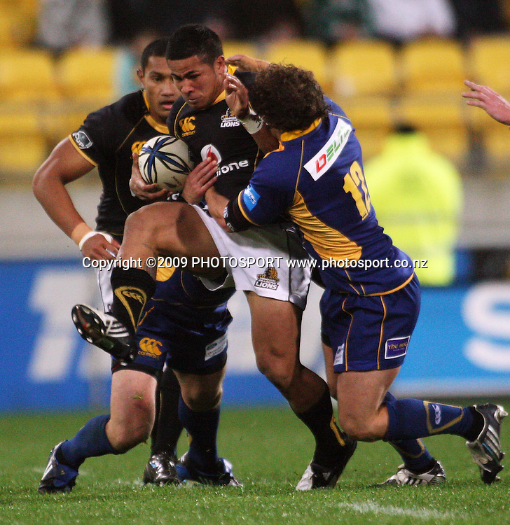 Wellington winger David Smith is tackled by Andrew Parata.<br /> Air NZ Cup Ranfurly Shield match - Wellington Lions v Otago at Westpac Stadium, Wellington, New Zealand. Friday, 31 July 2009. Photo: Dave Lintott/PHOTOSPORT