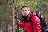 Young male backpacker in forest