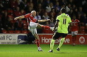 Walsall defender, James O'Connor clears during the Capital One Cup match between Walsall and Brighton and Hove Albion at the Banks's Stadium, Walsall, England on 25 August 2015.
