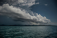 Storm building ashore on the main island of Palawan.  Shark Fin Bay, Palawan, Philippines.