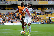 Ethan Ebanks-Landell battles with Karlan Ahearne-Grant during the Sky Bet Championship match between Wolverhampton Wanderers and Charlton Athletic at Molineux, Wolverhampton, England on 29 August 2015. Photo by Alan Franklin.