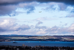 An aircraft over the River Forth, and Edinburgh as seen from the Edinburgh Castle Esplanade.