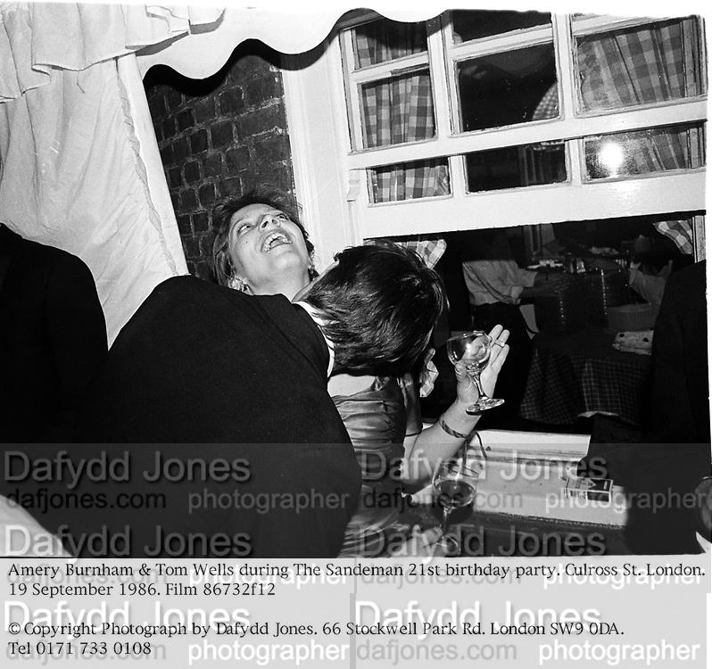 Amery Burnham & Tom Wells during The Sandeman 21st birthday party. Culross St. London. 19 September 1986. Film 86732f12<br /> © Copyright Photograph by Dafydd Jones. 66 Stockwell Park Rd. London SW9 0DA. Tel 0171 733 0108