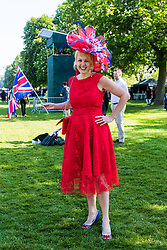 Alison Tinsley wears a patriotic hat as excitement builds on the Long Walk on the procession route ahead of the royal wedding. Windsor, May 19 2018.