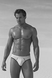 man with a perfect body wearing white briefs outdoors