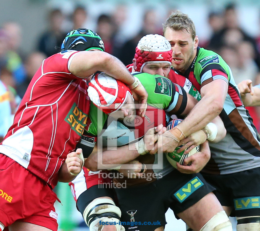 Picture by Michael Whitefoot/Focus Images Ltd 07969 898192<br /> 19/01/2014<br /> George Robson of Harlequins caught by some Scarlets during the Heineken Cup match at Parc y Scarlets, Llanelli.