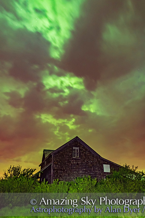 The great aurora of May 27/28, 2017 lighting up the clouds, also lit partly by light pollution, over the old house near home in southern Alberta.