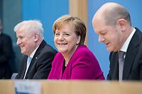 12 MAR 2018, BERLIN/GERMANY:<br /> Horst Seehofer (L), CSU, desig. Bundesinnenminister, Angela Merkel (M), CDU, Bundeskanzlerin, und Olaf Scholz (R), SPD, desig. Bundesfinanzminister, waehrend einer Pressekonferenz zum Koalitionsvertrag der CDU/CSU und SPD, Bundespressekonferenz<br /> IMAGE: 20180312-01-015<br /> KEYWORDS: freundlich
