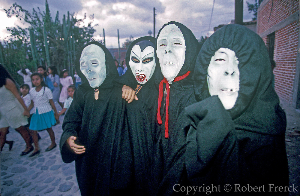 MEXICO, FESTIVALS, DAYS OF THE DEAD Masked figures doing a 'Danza de Muerto' or dance of death in Mitla near Oaxaca at dusk on Nov. 3rd.