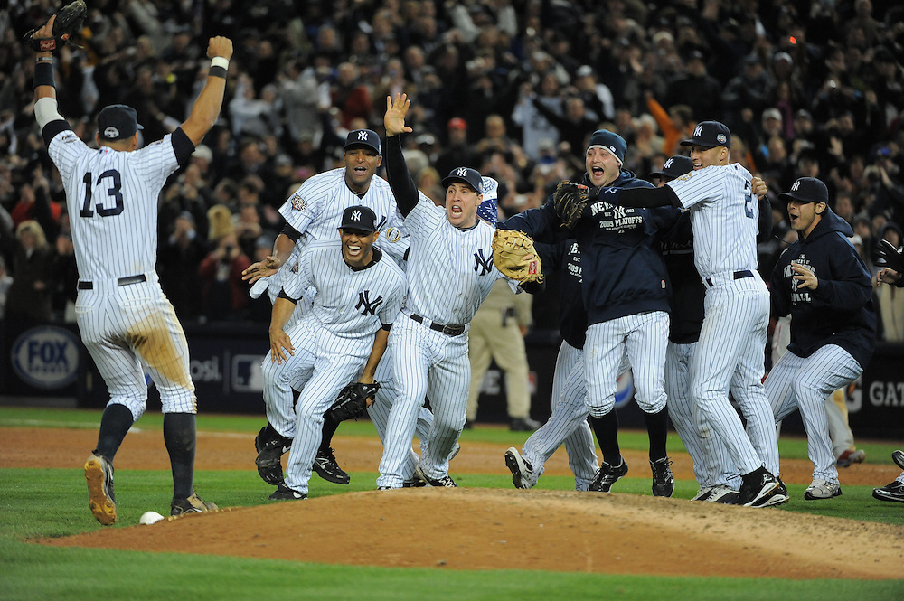 The New York Yankees celebrate winning the 2009 World Series.  (Photo by Ron Vesely/MLB Photos).