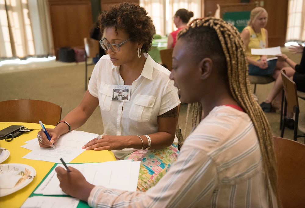 Allison Hunter fills out paperwork with her mentee during the Women's Mentoring Meet and Greet event on Sept. 4, 2018 in Walter Rotunda. Photo by Hannah Ruhoff