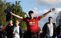 "Manchester United fans outside the ground before the Premier League match at Molineux, Wolverhampton. PRESS ASSOCIATION Photo. Picture date: Saturday August 11, 2018. See PA story SOCCER Wolves. Photo credit should read: Nick Potts/PA Wire. RESTRICTIONS: EDITORIAL USE ONLY No use with unauthorised audio, video, data, fixture lists, club/league logos or ""live"" services. Online in-match use limited to 120 images, no video emulation. No use in betting, games or single club/league/player publications."