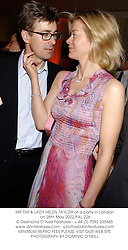 MR TIM & LADY HELEN TAYLOR at a party in London on 28th May 2002.			PAL 226