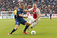 Onderwerp/Subject: Ajax - NEC - Eredivisie<br /> Reklame:  <br /> Club/Team/Country: <br /> Seizoen/Season: 2012/2013<br /> FOTO/PHOTO: Rens VAN EIJDEN (L) of NEC in duel with Kolbeinn SIGTHORSSON (R) of Ajax. (Photo by PICS UNITED)<br /> <br /> Trefwoorden/Keywords: <br /> #04 $94 ±1355239233217 ±1355239233217<br /> Photo- & Copyrights © PICS UNITED <br /> P.O. Box 7164 - 5605 BE  EINDHOVEN (THE NETHERLANDS) <br /> Phone +31 (0)40 296 28 00 <br /> Fax +31 (0) 40 248 47 43 <br /> http://www.pics-united.com <br /> e-mail : sales@pics-united.com (If you would like to raise any issues regarding any aspects of products / service of PICS UNITED) or <br /> e-mail : sales@pics-united.com   <br /> <br /> ATTENTIE: <br /> Publicatie ook bij aanbieding door derden is slechts toegestaan na verkregen toestemming van Pics United. <br /> VOLLEDIGE NAAMSVERMELDING IS VERPLICHT! (© PICS UNITED/Naam Fotograaf, zie veld 4 van de bestandsinfo 'credits') <br /> ATTENTION:  <br /> © Pics United. Reproduction/publication of this photo by any parties is only permitted after authorisation is sought and obtained from  PICS UNITED- THE NETHERLANDS