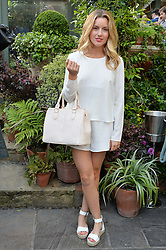 CAGGIE DUNLOP at a party to celebrate 'A Year In The Garden' celebrating the first year of The Ivy Chelsea Garden, 197 King's Road, London on 16th May 2016.