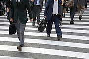 businessmen crossing a zebra