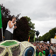 Green Party MP Caroline Lucas speaks to the crowd outside the gate to the Cuadrilla frack site. Thousands turned out for a march of solidarity against fracking in Balcombe. The village Balcombe in Sussex is the  centre of fracking by the company Cuadrilla. The march saw anti-fracking movements from the Lancashire and the North, Wales and other communities around the UK under threat of gas and oil exploration by fracking.