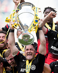 Saracens inside centre Brad Barritt lifts the Aviva Premiership trophy as Saracens are crowned Aviva Premiership champions  - Mandatory by-line: Joe Meredith/JMP - 17/01/2014 - RUGBY - Twickenham - London, England - Saracens v Exeter Chiefs - Aviva Premiership Final