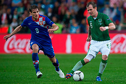 10.06.2012, Staedtisches Stadion, Posen, POL, UEFA EURO 2012, Irland vs Kroatien, Gruppe C, im Bild NIKICA JELAVIC, GLENN WHELAN // during the UEFA Euro 2012 Group C Match between Ireland and Croatia at the Municipal Stadium Poznan, Poland on 2012/06/10. EXPA Pictures © 2012, PhotoCredit: EXPA/ Newspix/ Jakub Kaczmarczyk..***** ATTENTION - for AUT, SLO, CRO, SRB, SUI and SWE only *****