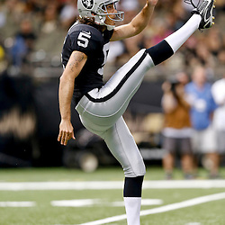 Aug 16, 2013; New Orleans, LA, USA; Oakland Raiders punter Chris Kluwe (5) against the New Orleans Saints during the first quarter of a preseason game at the Mercedes-Benz Superdome. Mandatory Credit: Derick E. Hingle-USA TODAY Sports