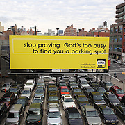 A sign of the times?A parking advertisement in Chelsea, Manhattan, New York City viewed from High Line. New York, USA. 17th January 2013. Photo Tim Clayton