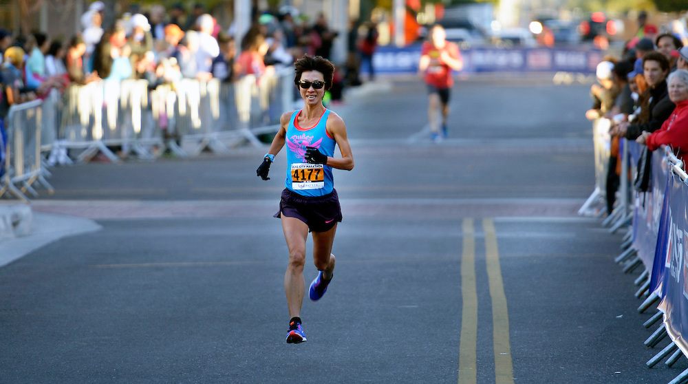 gbs101616r/SPORTS -- Minori Hayakari of Albuquerque sprints to the finish to win the women's 5K run during the Duke City Marathon on Sunday, October 16, 2016. (Greg Sorber/Albuquerque Journal)