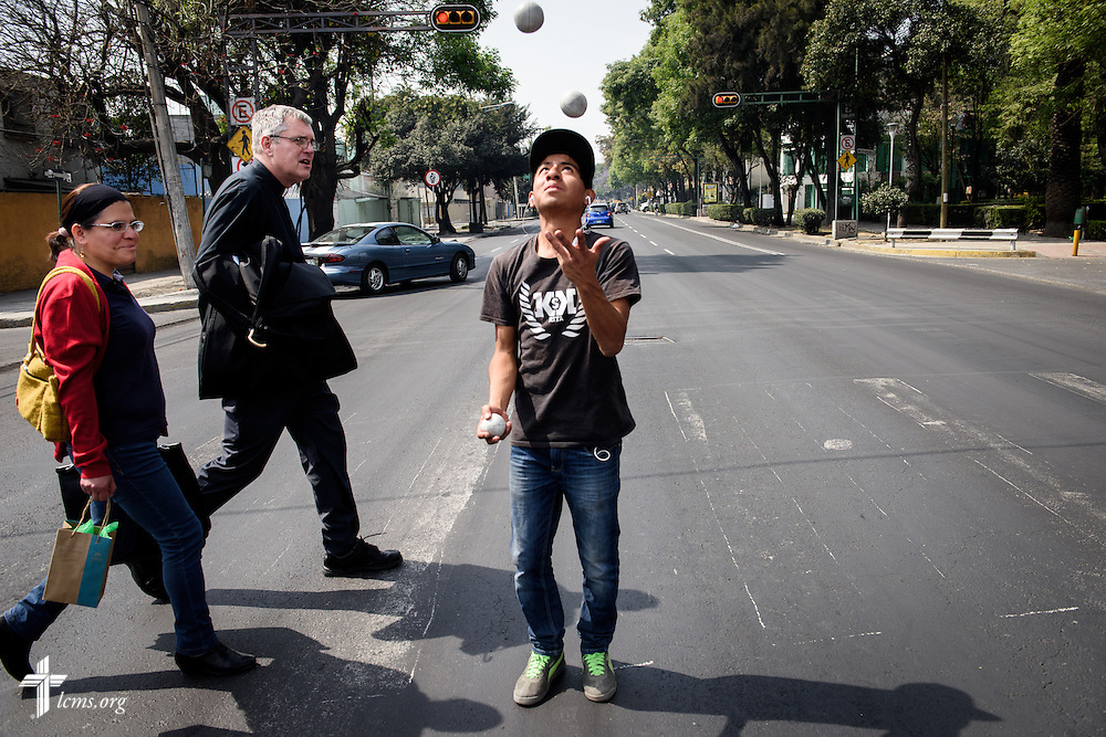 The Rev. Daniel Conrad, LCMS missionary to Mexico, walks with a new visitor from worship near the Lutheran Church of San Pedro on Sunday, Feb. 14, 2016, in Mexico City, Mexico. LCMS Communications/Erik M. Lunsford