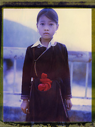 Polaroid 79's portrait of a little ethnic girl standing on a bridge