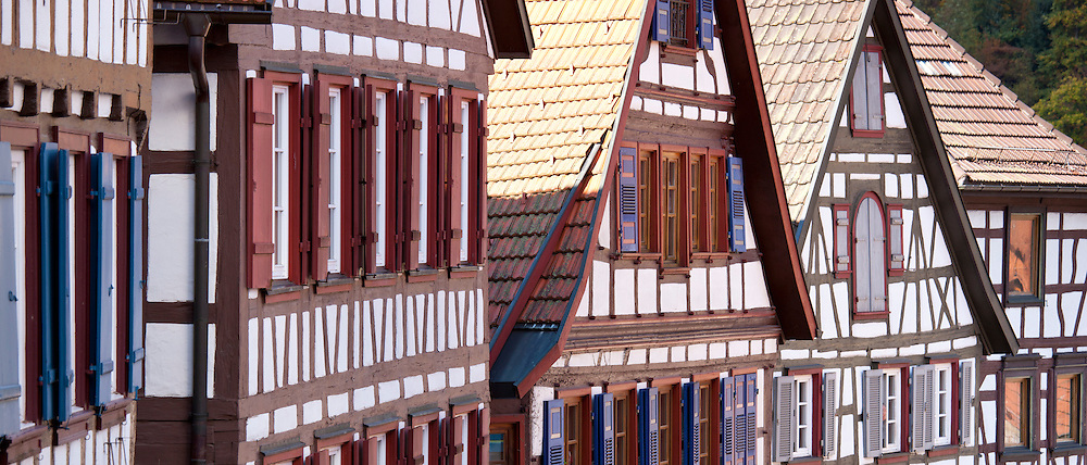Windows and wooden shutters of quaint timber-framed houses in Schiltach in the Bavarian Alps, Germany