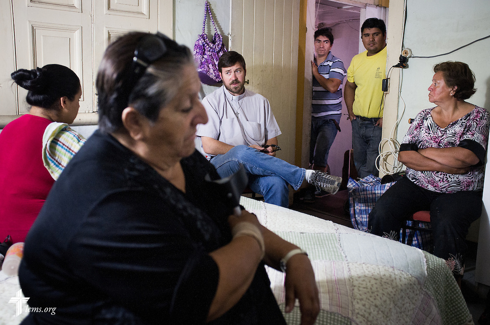 The Rev. Cristian E. Rautenberg, president of the Confessional Lutheran Church of Chile, makes a home visit to a family on Wednesday, April 23, 2014, in Iquique, Chile. The city was damaged from a magnitude 8.2 earthquake on April 1, 2014 approximately 95km northwest of Iquique. The earthquake condemned several thousand homes and severely damaged more than ten thousand others. LCMS Communications/Erik M. Lunsford