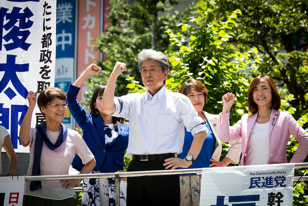 TOKYO, JAPAN - JULY 30 : Journalist Shuntaro Torigoe, a candidate for Tokyo governor and his team raised their fists together after the campaign speech during the last day of Tokyo Gubernatorial Election campaign rally at Hachiōji Station, Tokyo, Japan on Saturday, July 30, 2016. Tokyo residents will vote on July 31 for a new Governor of Tokyo who will deal with issues related to the hosting of the Tokyo Summer Olympics and Paralympics in 2020. (Photo: Richard Atrero de Guzman/NUR Photo)