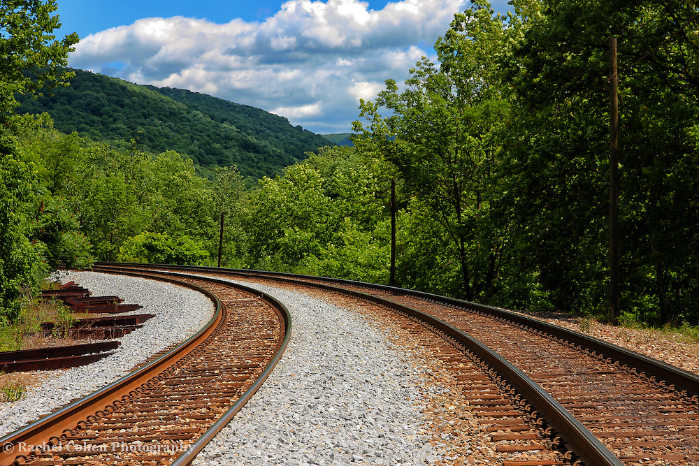 &quot;Double Blind&quot;<br /> <br /> If you love railroad tracks, then this double set is sure to please. Going straight through Ohiopyle and winding it's way through the lush green valley with mountains and amazing skies above!!<br /> <br /> Laurel Highlands Area of Pennsylvania by Rachel Cohen