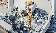 A technical team member from Miami-Dade Fire Rescue responds to the FIU bridge collapse in Miami, Florida, Thursday, March 15, 2018. <br />