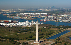 Aerial view of the Port of Houston with the San Jacinto Monument and Houston skyline