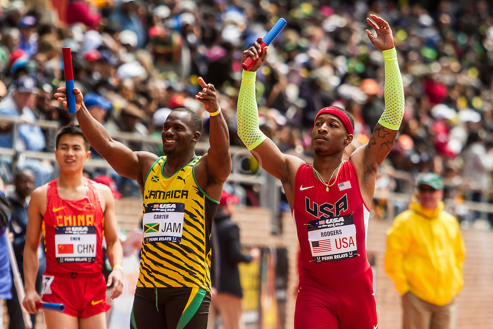 Penn Relays, USA vs the World, 4x 100 meters, Michael Rodgers, USA and Nesta Carter, Jamaica