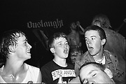 Three young punks at a Peter and the Test Tube Babies gig in AD LIB club in London, UK, 1980s.