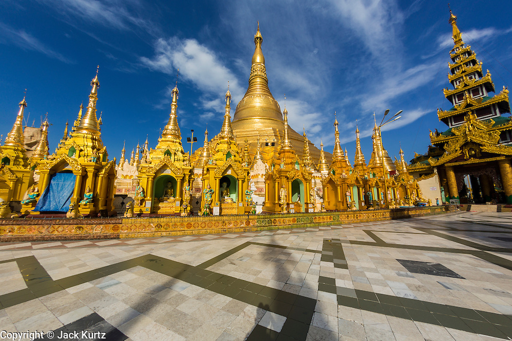 15 JUNE 2013 - YANGON, MYANMAR:  Shwedagon Pagoda in Yangon. The Shwedagon Pagoda is officially known as Shwedagon Zedi Daw and is also called the Great Dagon Pagoda or the Golden Pagoda. It is a 99 metres (325ft) tall pagoda and stupa located in Yangon, Burma. The pagoda lies to the west of on Singuttara Hill, and dominates the skyline of the city. It is the most sacred Buddhist pagoda in Myanmar and contains relics of the past four Buddhas enshrined: the staff of Kakusandha, the water filter of Koṇāgamana, a piece of the robe of Kassapa and eight strands of hair fromGautama, the historical Buddha. The pagoda was built between the 6th and 10th centuries by the Mon people, who used to dominate the area around what is now Yangon (Rangoon). The pagoda has been renovated numerous times through the centuries. Millions of Burmese and tens of thousands of tourists visit the pagoda every year, which is the most visited site in Yangon. PHOTO BY JACK KURTZ