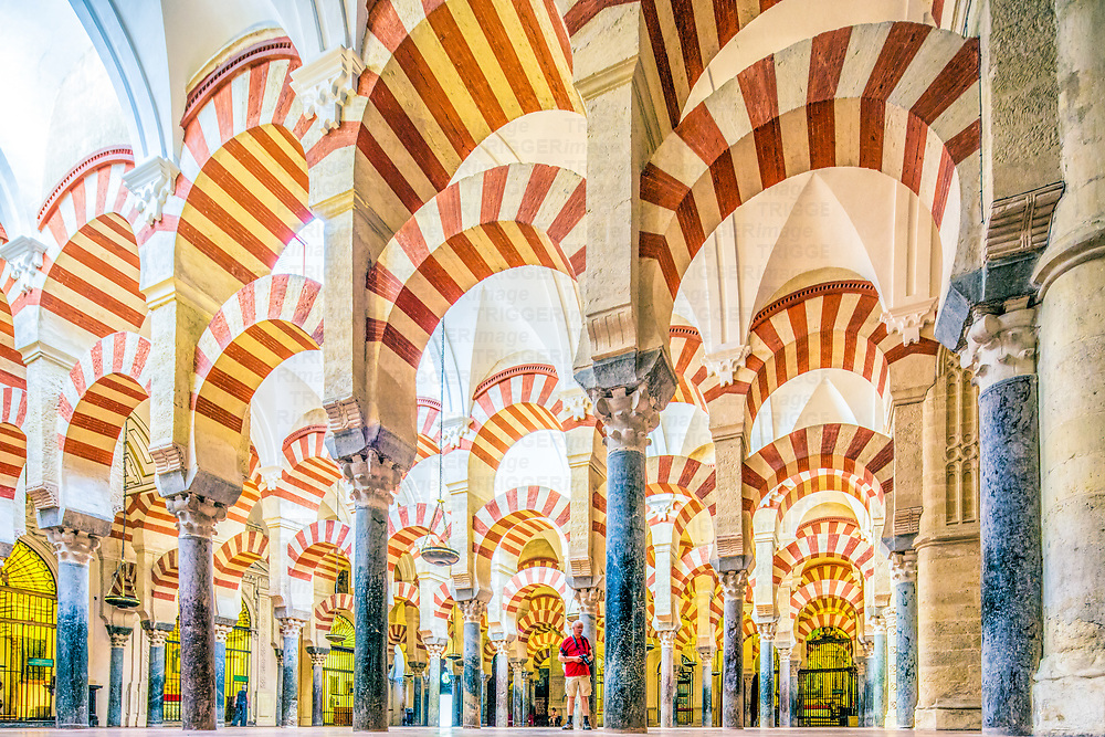Decorative tiles and arches in the Mosque of Cordoba, Spain