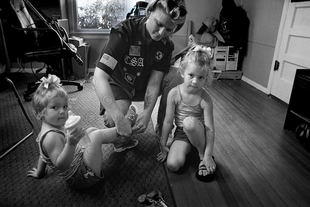 A militant of the White Power is visiting his friends with his two daughters.