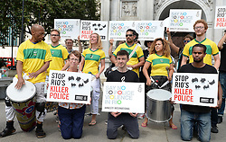 Kate Allen, the UK Director of Amnesty International, (front left) joins a group of demonstrators to protest declaring 'Say no to police violence in Rio', with a band of Samba drummers at Marble Arch in London.