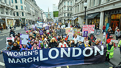 "© Licensed to London News Pictures. 19/01/2019. LONDON, UK.  Thousands of participants take part in the Women's March in the capital, one of 30 such worldwide marches protesting against violence against women and the negative impact of austerity policies.  London's theme this year is ""Bread and Roses"", honouring Polish-American suffragette Rose Schneiderman who, in 1911 said ""The worker must have bread but she must have roses too"", in response to a factory fire where 146 mainly female garment workers died.  Photo credit: Stephen Chung/LNP"