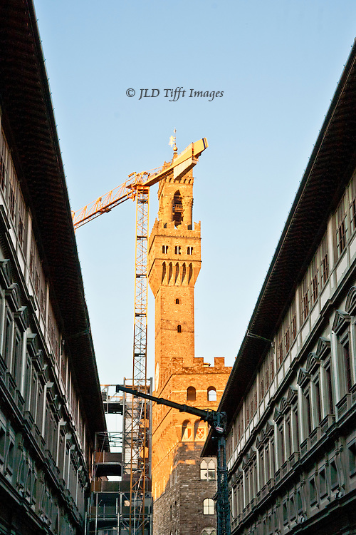 Construction cranes are everywhere as various monuments are patched and polished.  This view of the Palazzo Vecchio is from the courtyard of the Uffizi Gallery, a construction crane silhouetted against the sky, and the tower of the Palazzo Vecchio burnished by light from the setting sun.