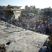 August 15, 2012 - Azaz, Aleppo, Syria: Rescuers scour the rubble in search of survivors and casualties of a Syrian warplanes airstrike on the northern town of Azaz near Aleppo. 30 people are reported to be killed and more than 100 wounded. (Paulo Nunes dos Santos/Polaris)
