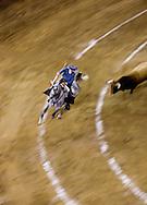 A Rejoneador bullfighter battles a bull in the Plaza de Toros in Morelia, Mexico.