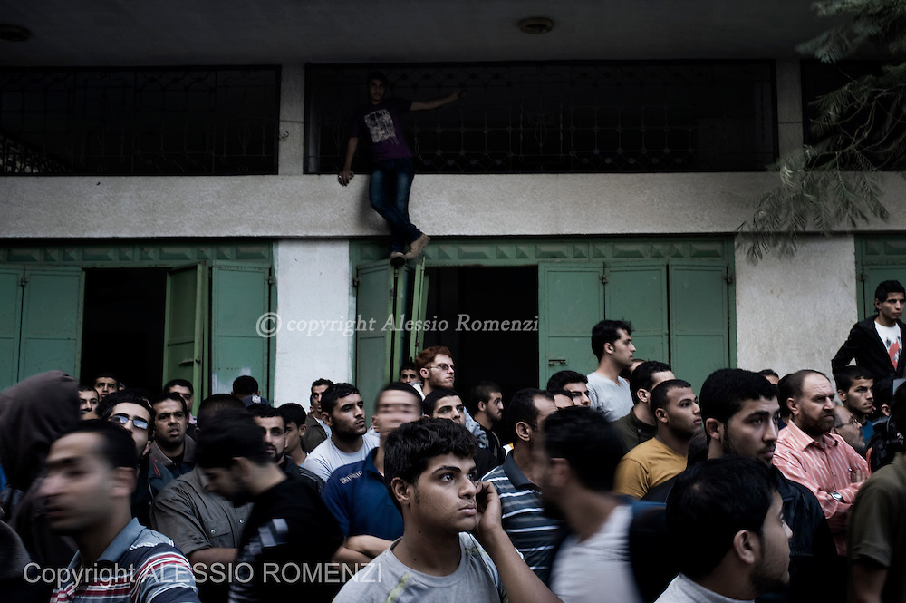 Gaza City: Palestinians observe rescue operations in a house, after was bombed by Israeli Air Force. November 18, 2012. ALESSIO ROMENZI