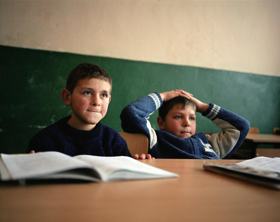 Children listen to their teacher in a religion class in the school in Ribnovo. The village has just one school and in the morning it functions as a secondary school, while in the afternoon the younger students come and it's a primary school.